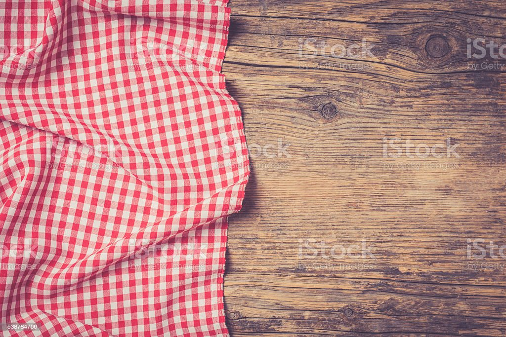 Checkered tablecloth on wooden table stock photo