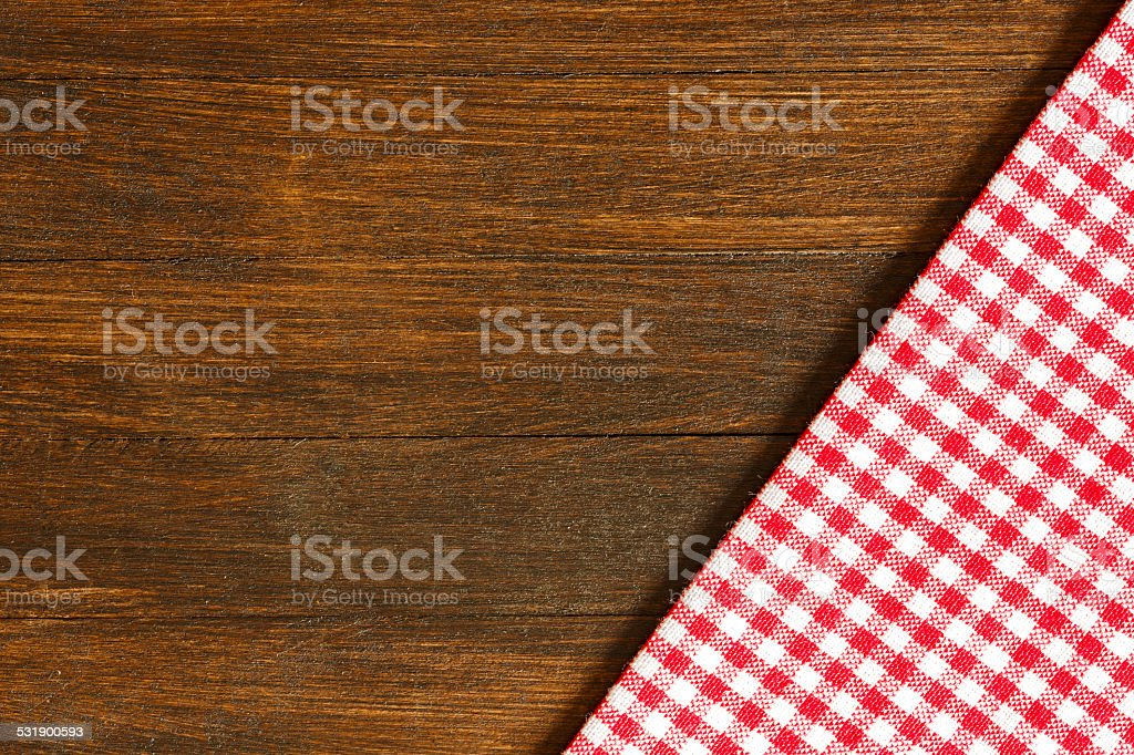 Checkered Tablecloth Wooden Background stock photo