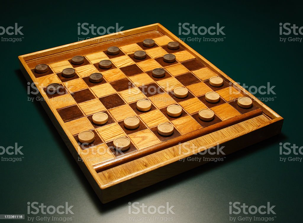 Checkers! Make your move! Checkerboard on Green Table royalty-free stock photo