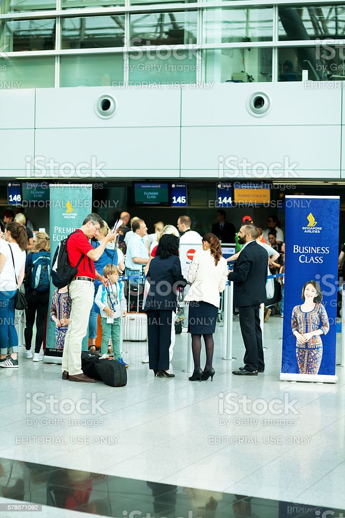 Check-in and service at Singapore Airlines stock photo