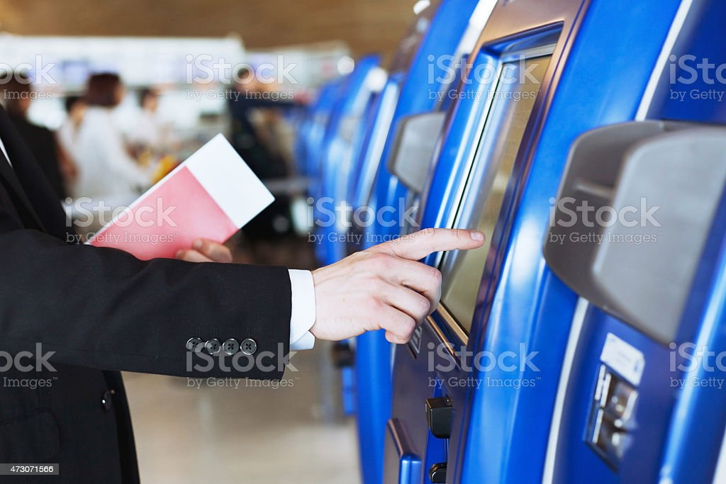 check-in at self help desk stock photo