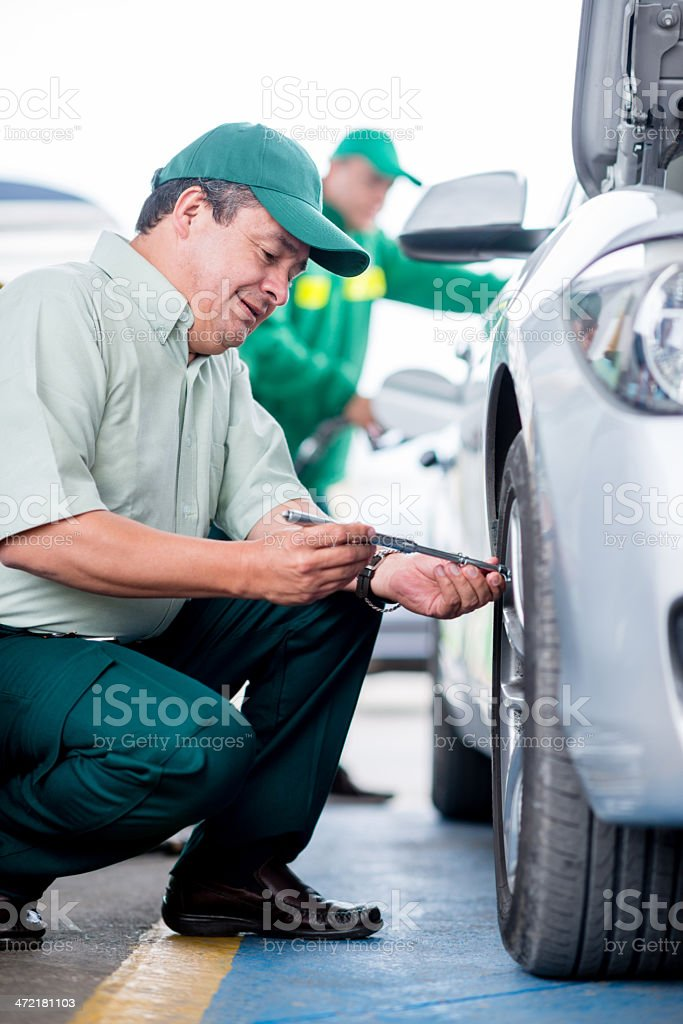 Checking air level on tires stock photo