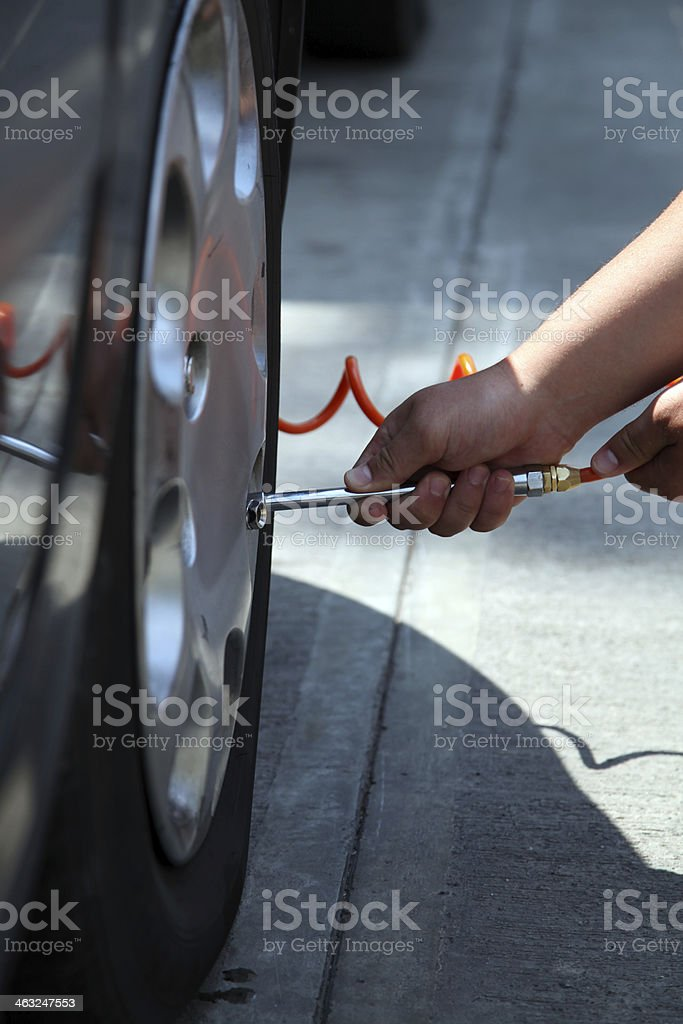 checking air pressure on a tire stock photo