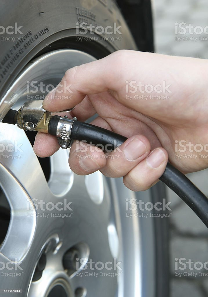 checking air pressure on a tire/ tyre royalty-free stock photo
