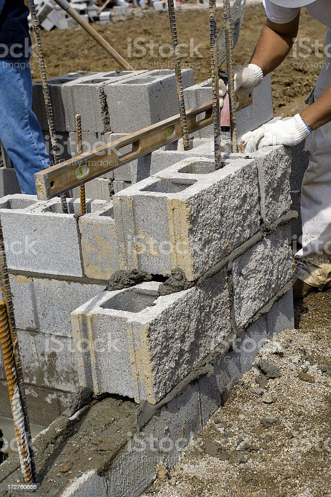 Checking Alignment of Cinder blocks royalty-free stock photo