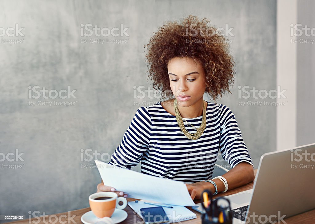 Checking and rechecking the figures stock photo