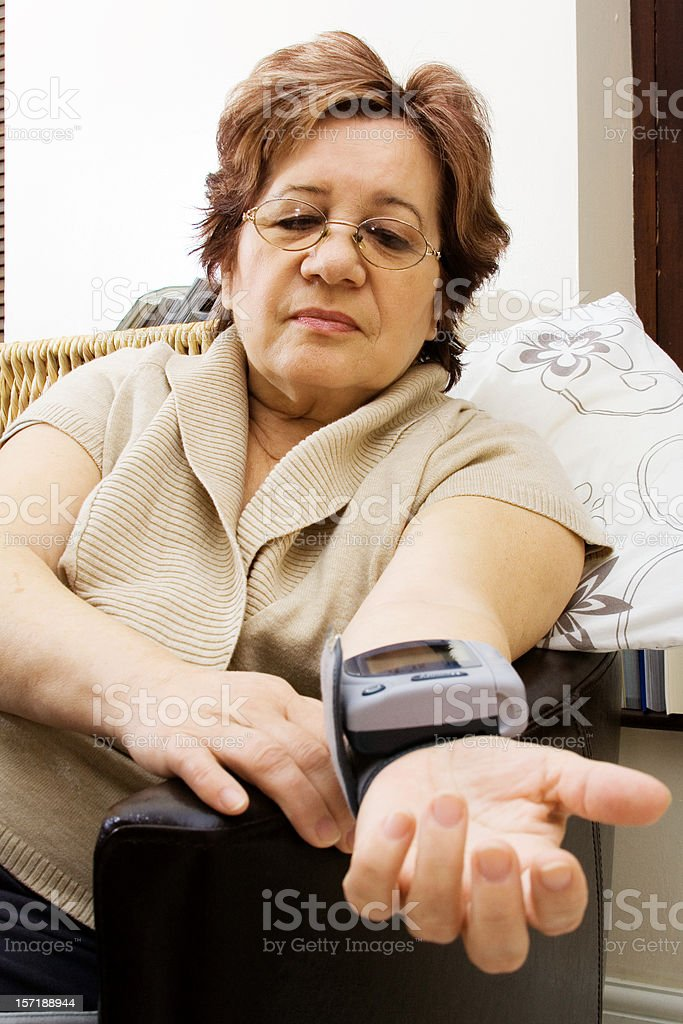 Checking blood pressure royalty-free stock photo