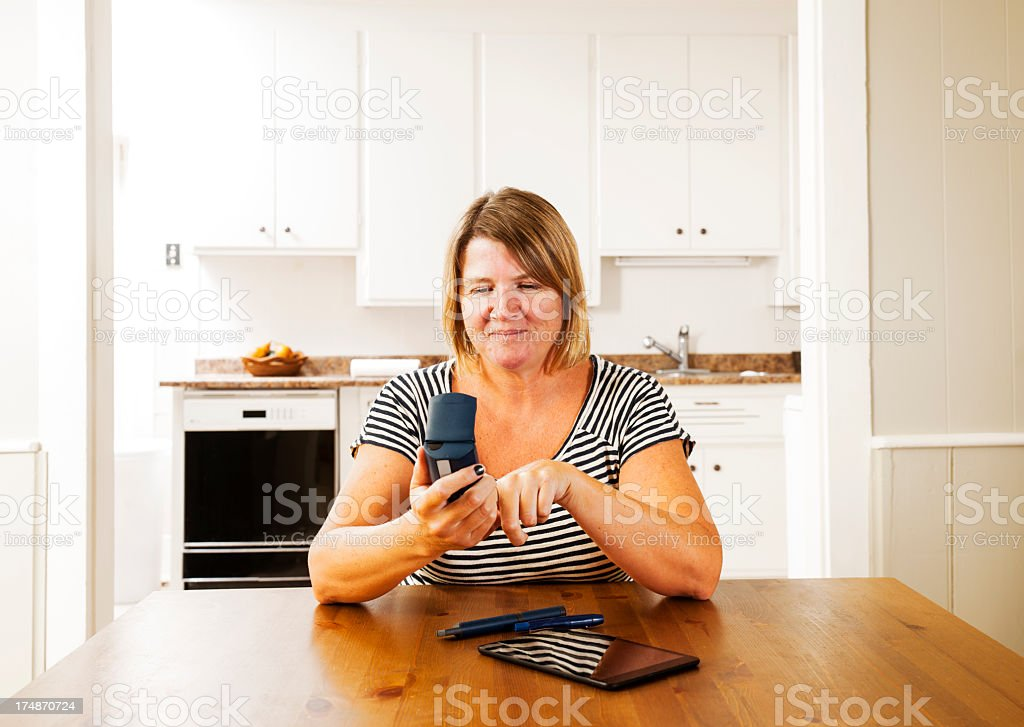 Checking blood sugar, glucose levels at home stock photo