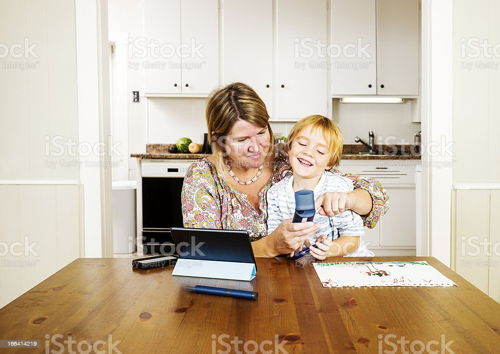 Checking blood sugar, glucose levels in the kitchen royalty-free stock photo