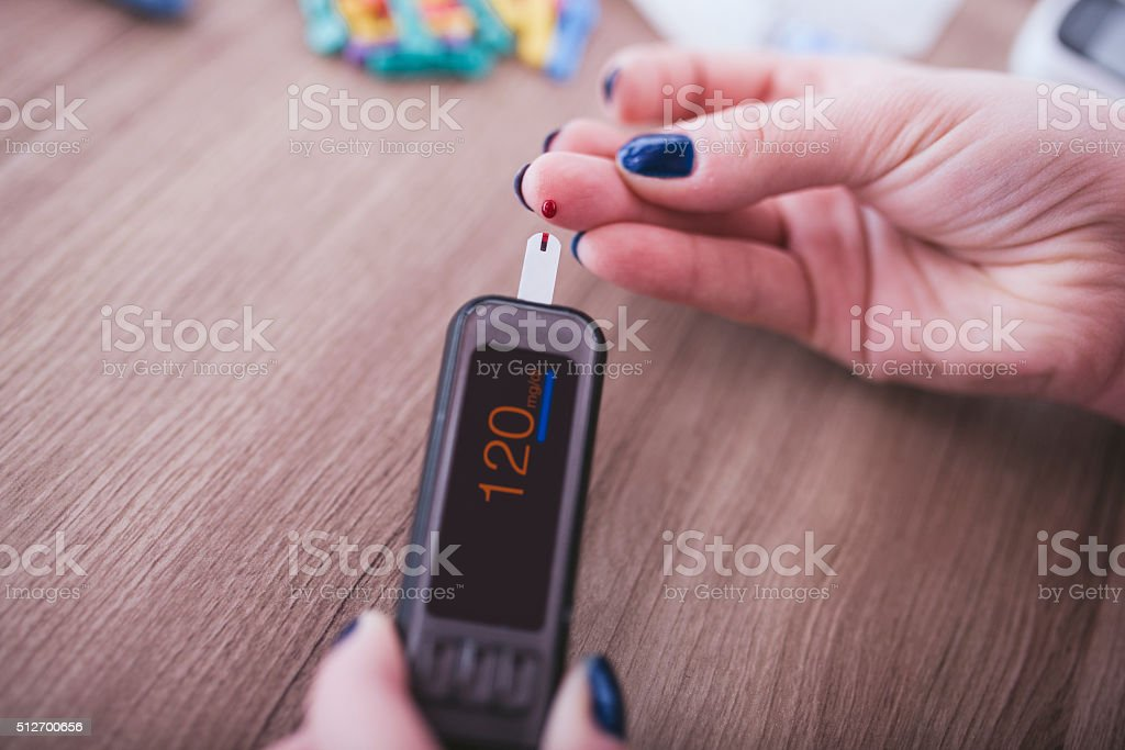 Checking blood sugar stock photo