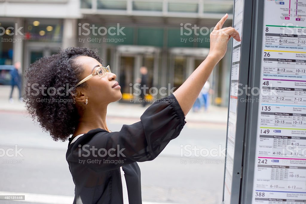 checking bus timetable royalty-free stock photo