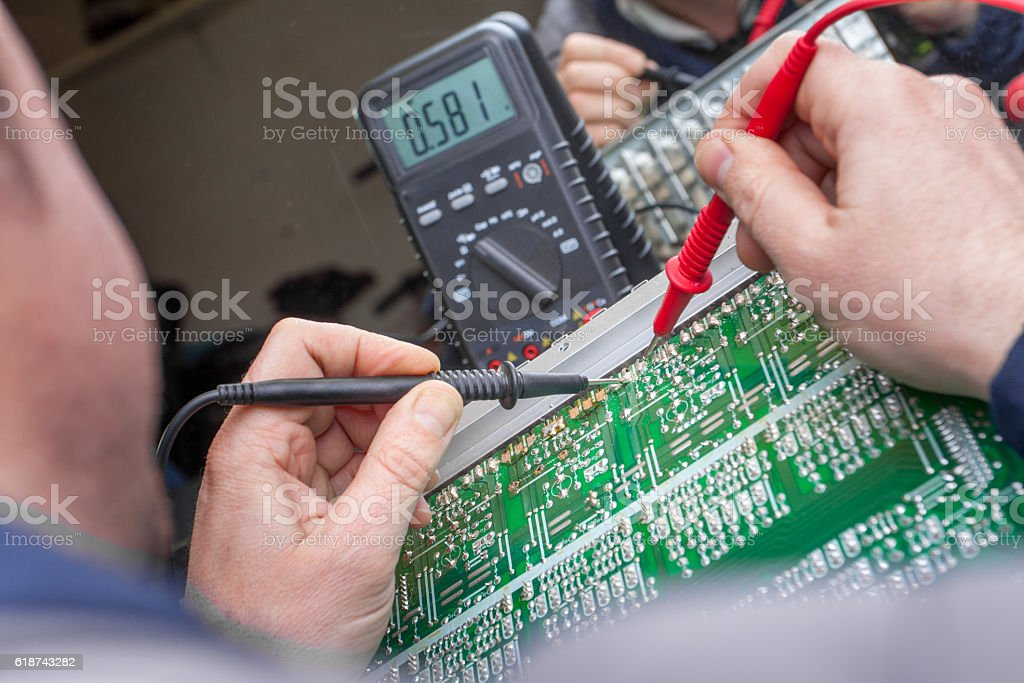 Checking circuit by Multimeter. Electrical engineer on during ch stock photo