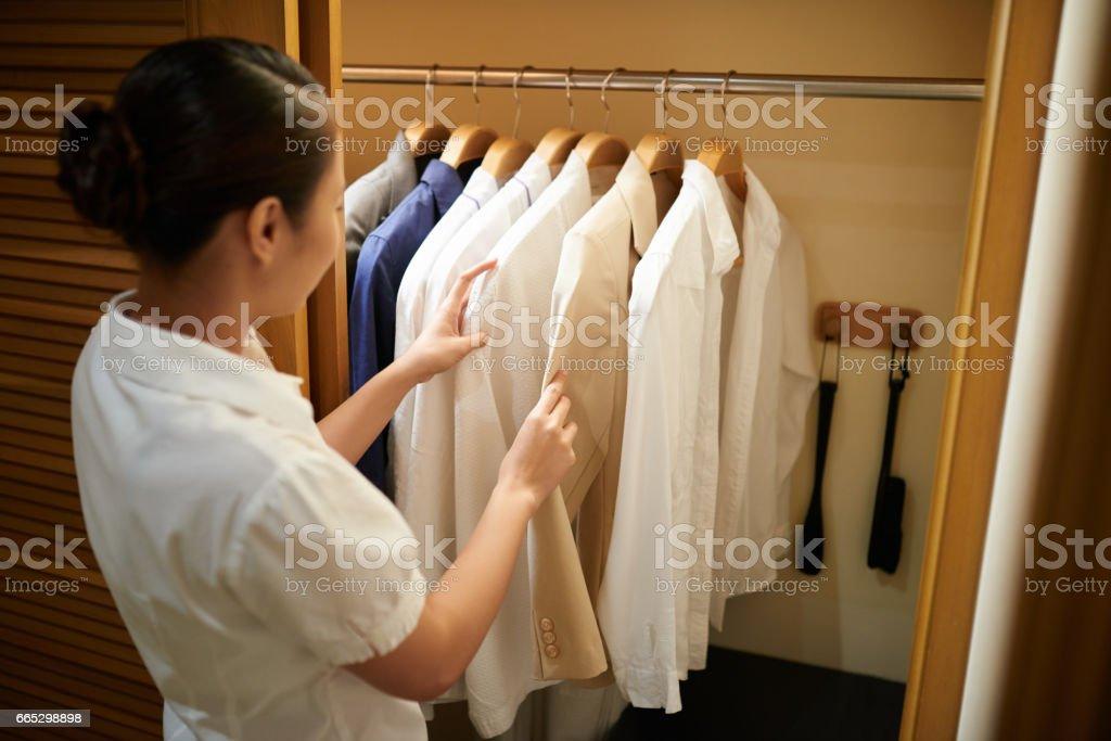 Checking clothes stock photo