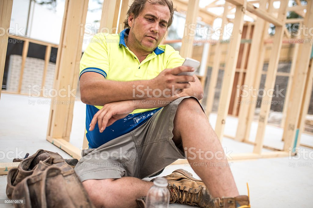 Checking construction plan of a house stock photo