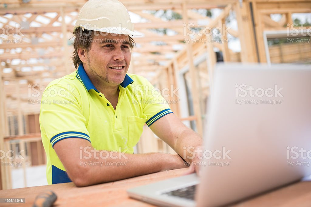 Checking construction plans stock photo