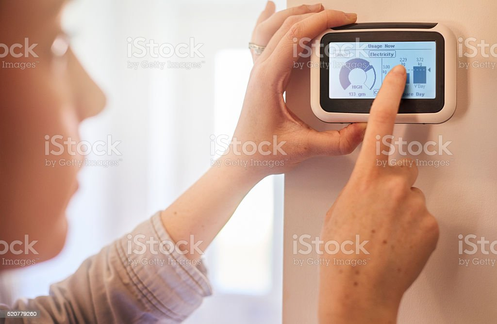 Checking energy consumption stock photo