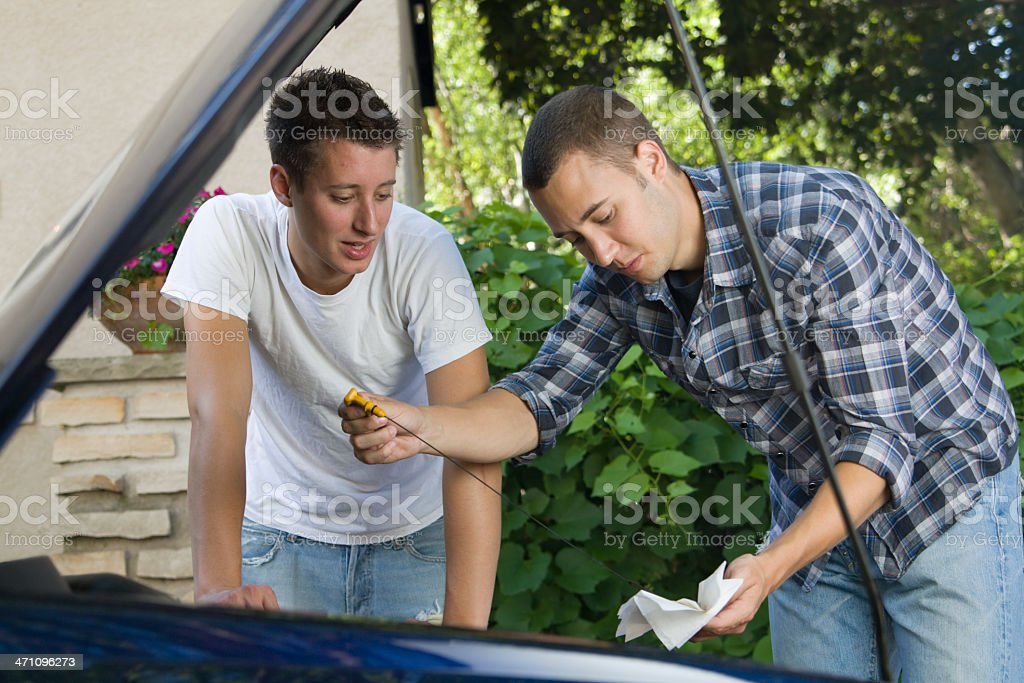 Checking Engine Oil stock photo
