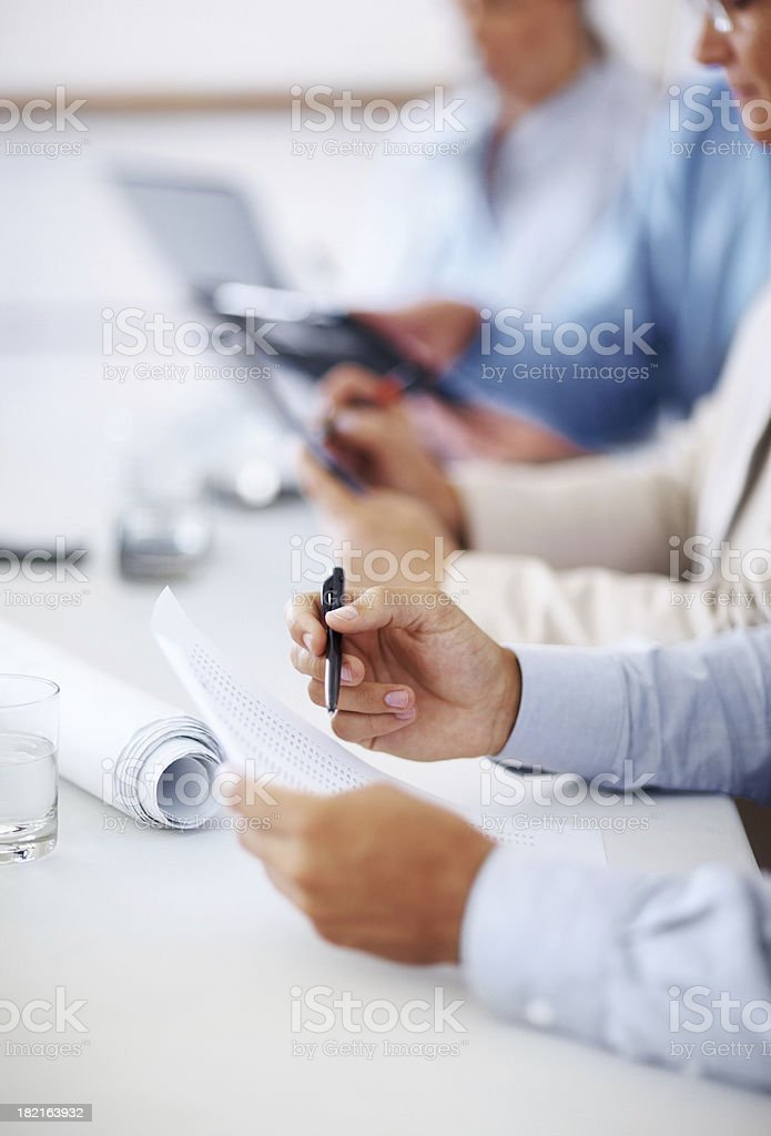 Checking financial figures during a meeting royalty-free stock photo