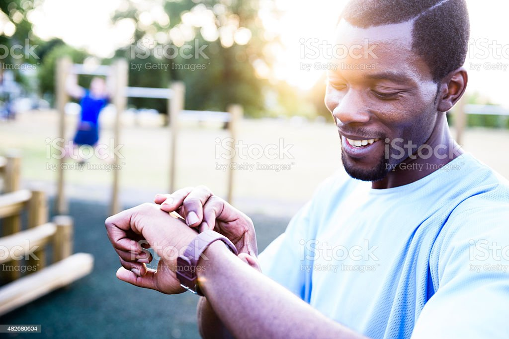Checking fitness stats on smart watch stock photo