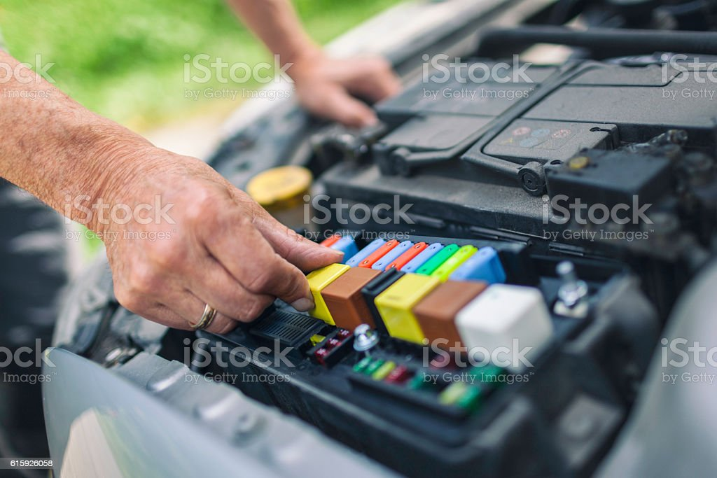 Checking fuses under the hood stock photo