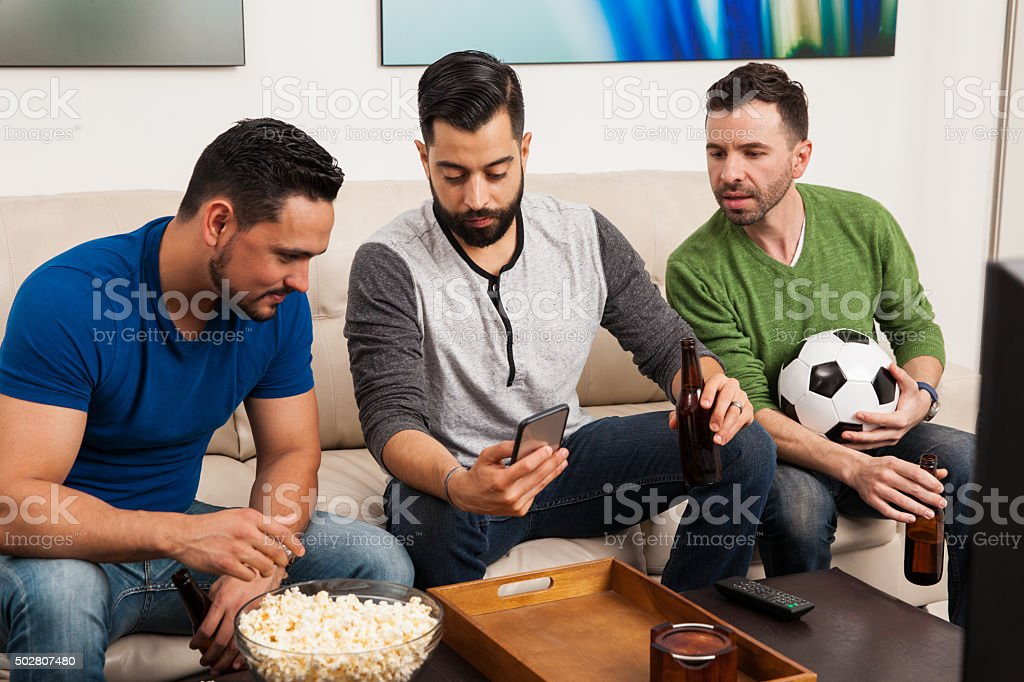 Checking game stats on a phone stock photo