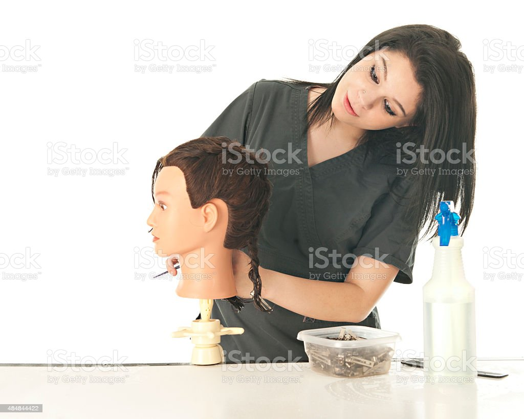 Checking Her Mannequin's Hair-Do stock photo