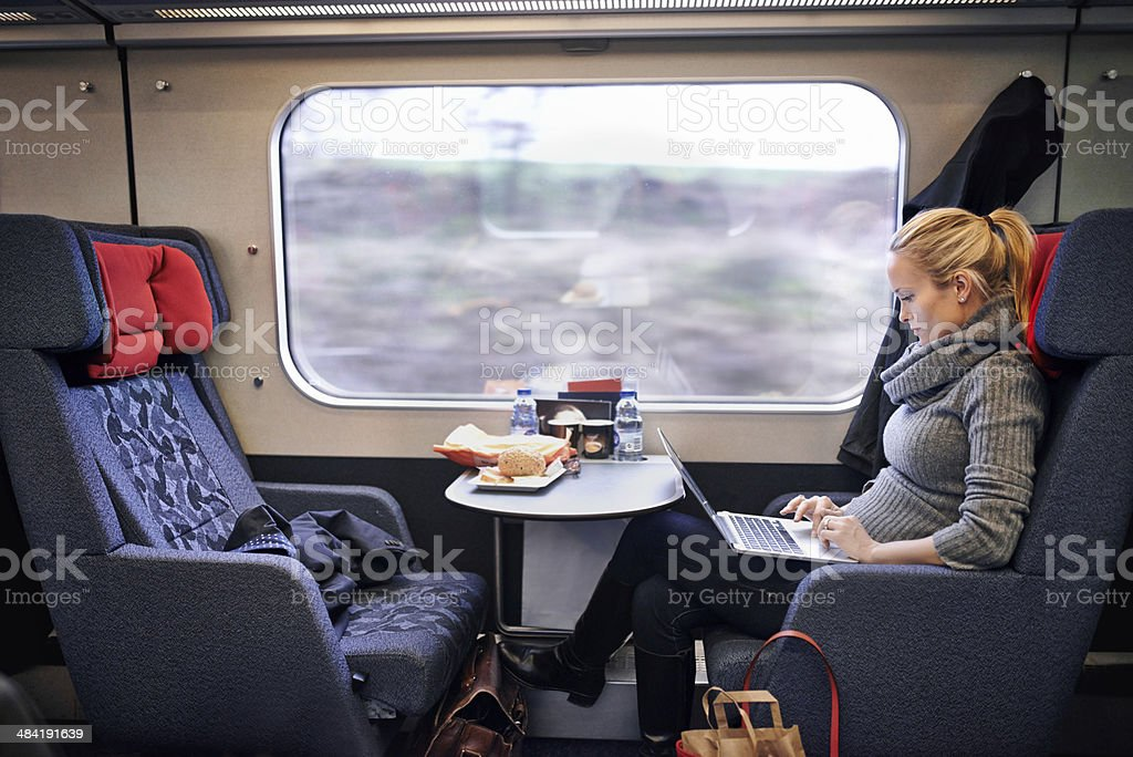 Checking her social media to pass the traveling time royalty-free stock photo