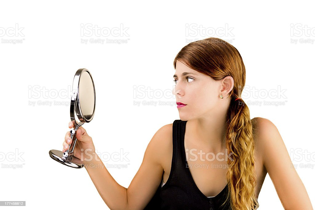 Checking herself in the mirror royalty-free stock photo