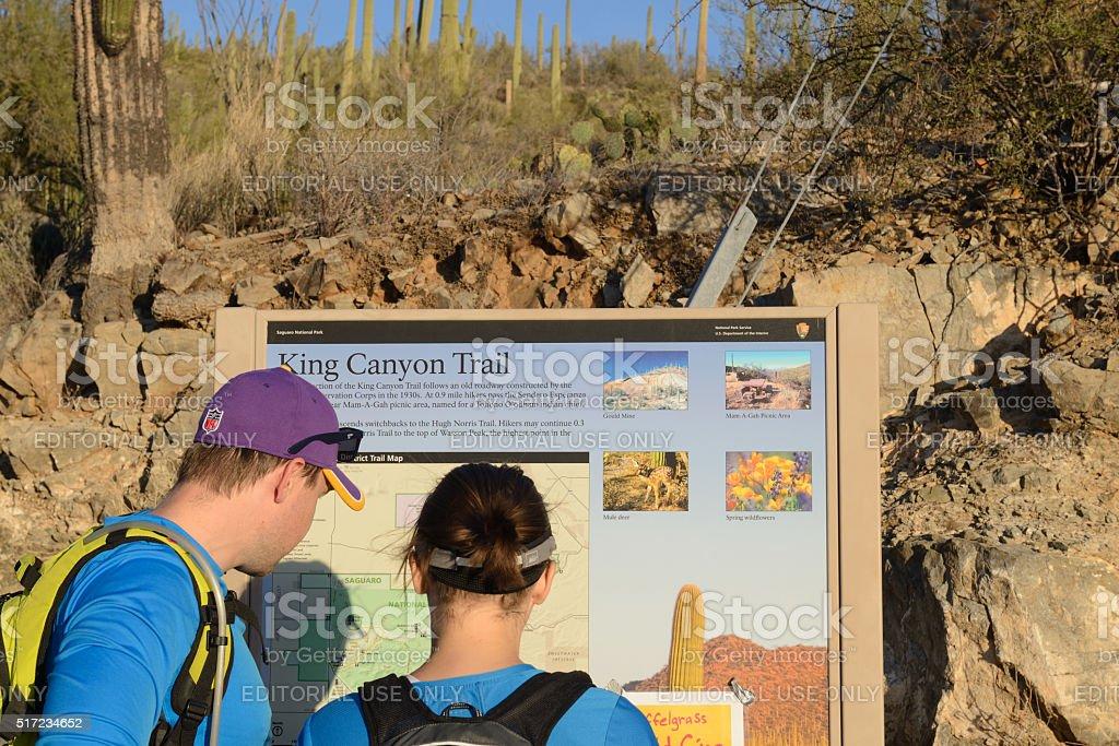 Checking Hiking Trail Map at Saguaro National Park stock photo
