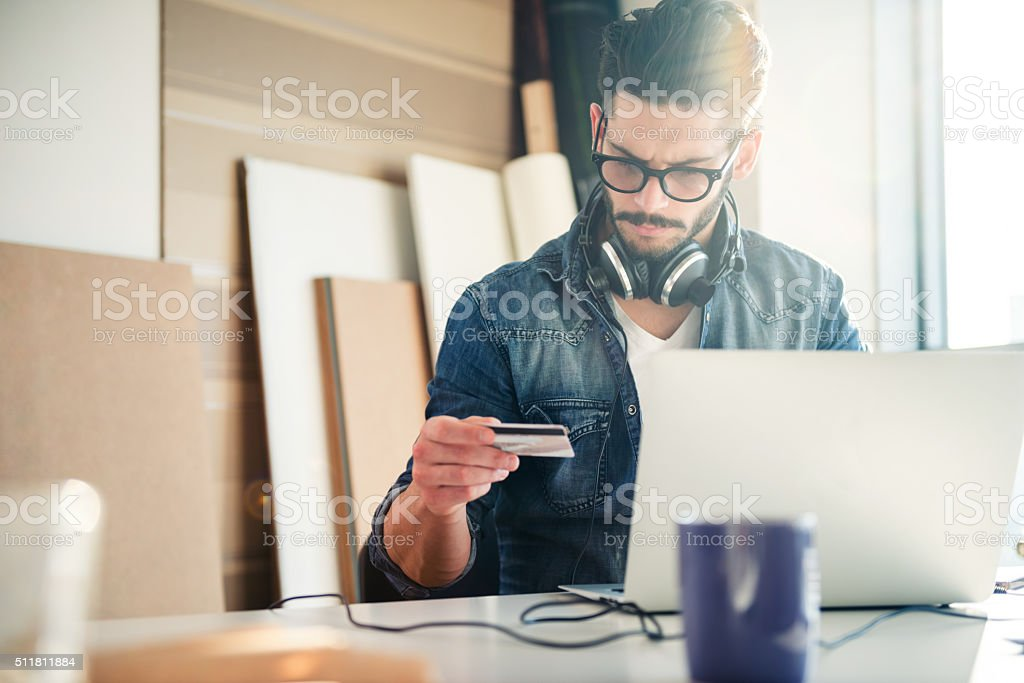 Checking his account stock photo