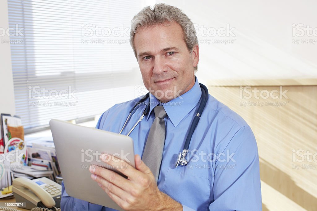 Checking his appointment logs royalty-free stock photo
