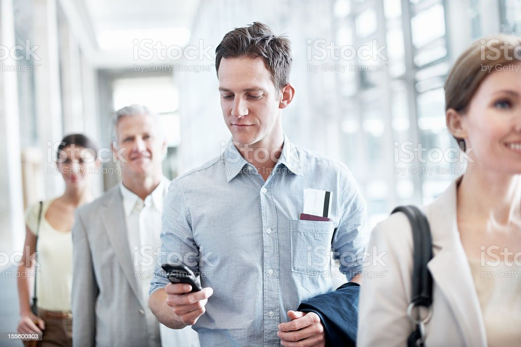 Checking his departure details royalty-free stock photo
