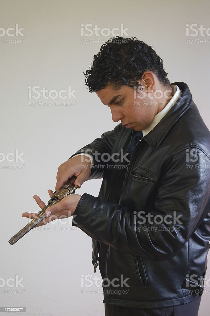 Checking His Gun stock photo