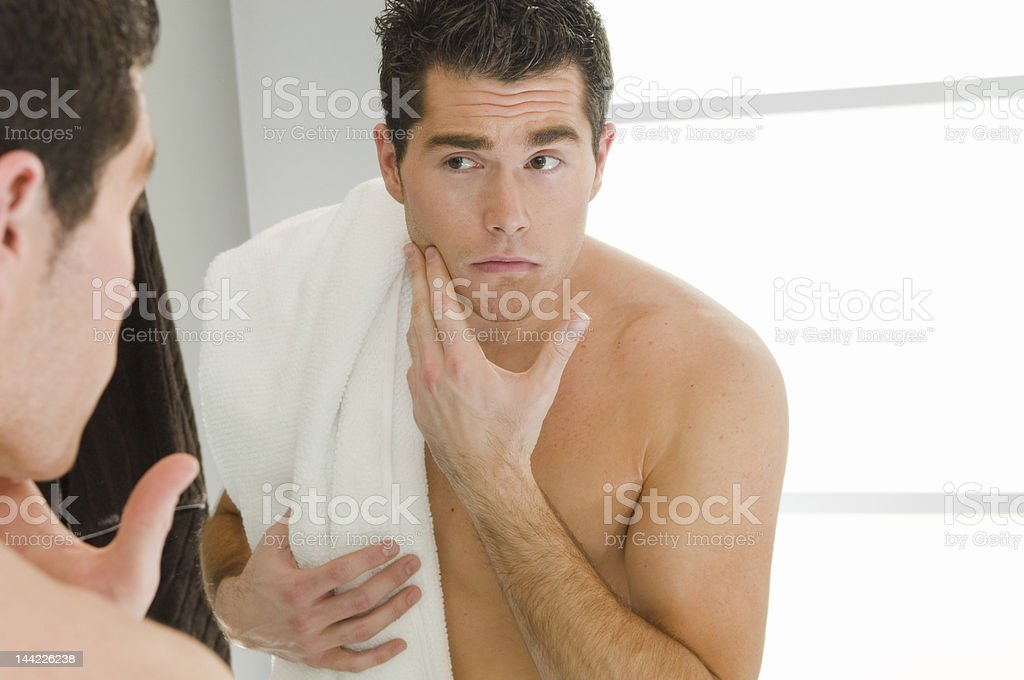 Checking his shave stock photo