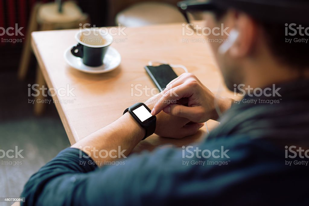 Checking his smartwatch stock photo