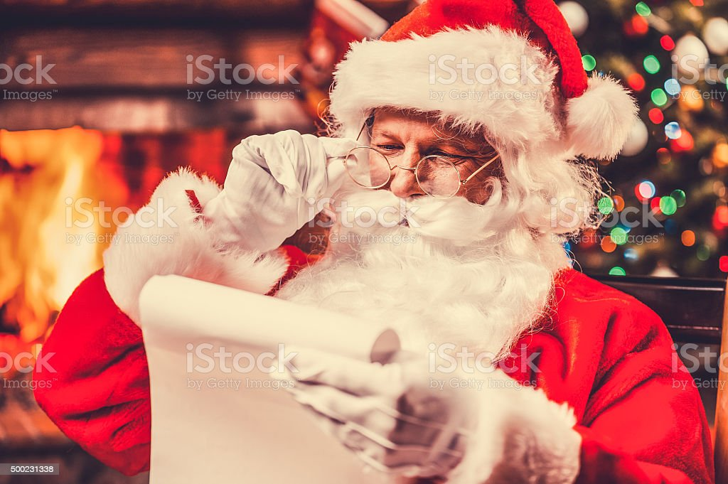 Checking his special list. stock photo
