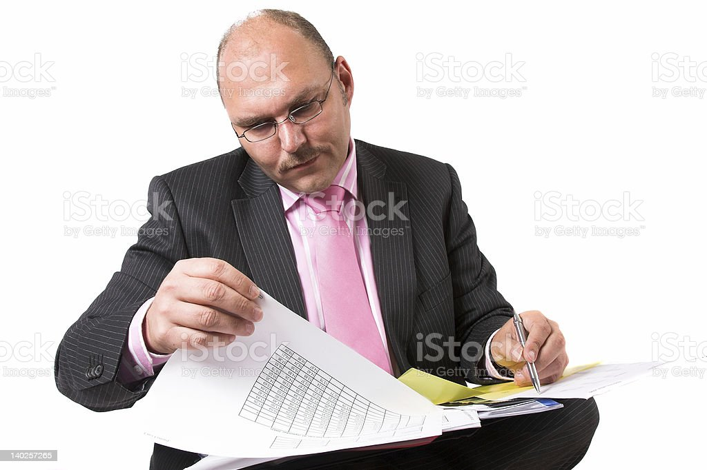 Checking his spreadsheets royalty-free stock photo