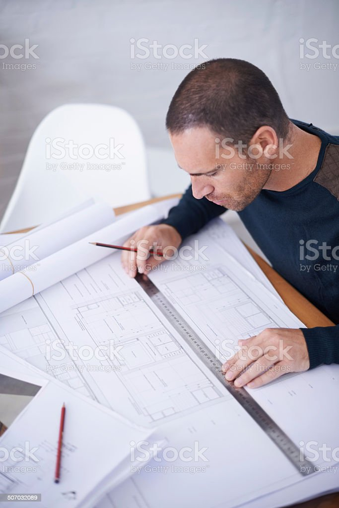 Checking his work to ensure the highest standard stock photo