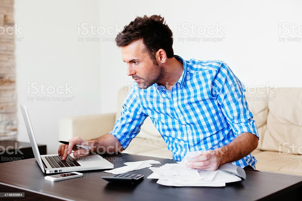 Checking home finance stock photo