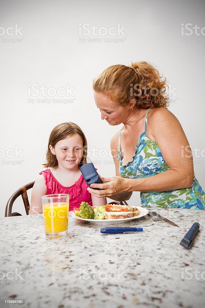 Checking juvenile blood glucose levels stock photo