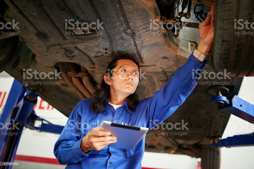 Checking lifted car stock photo