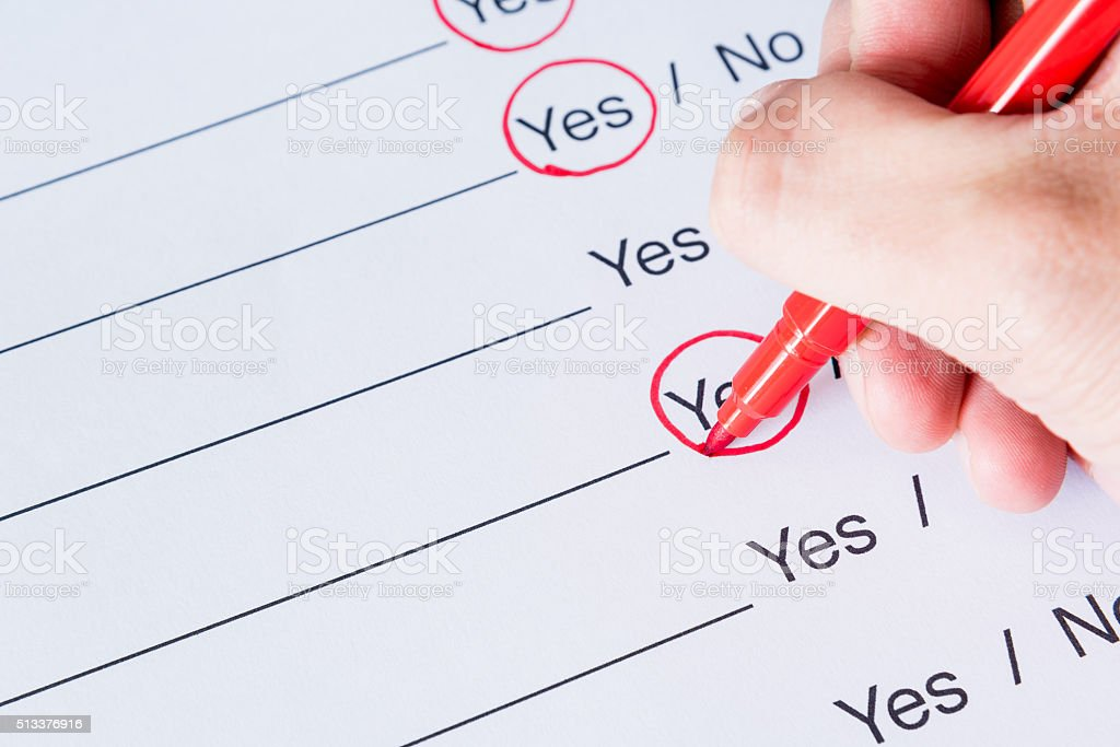 Checking list yes or no with red pen stock photo