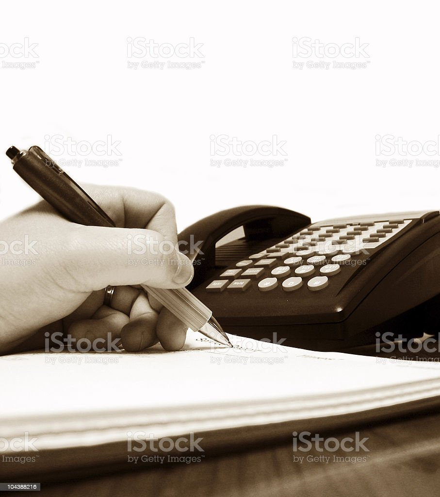 Checking messages -sepia tone royalty-free stock photo