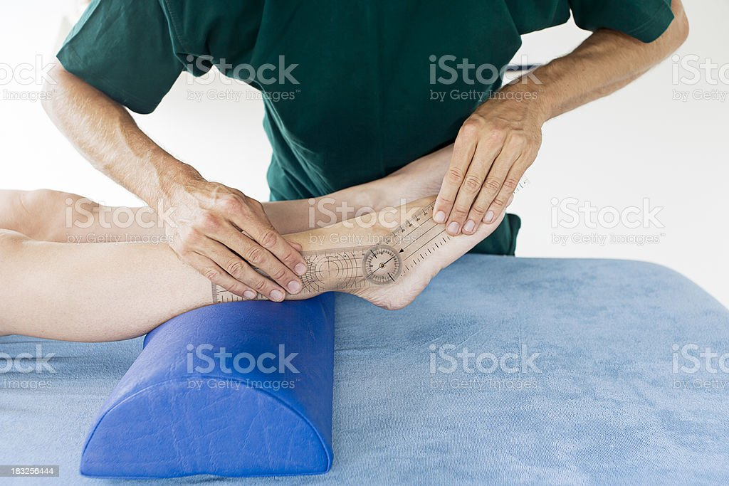 Checking mobility of a foot stock photo