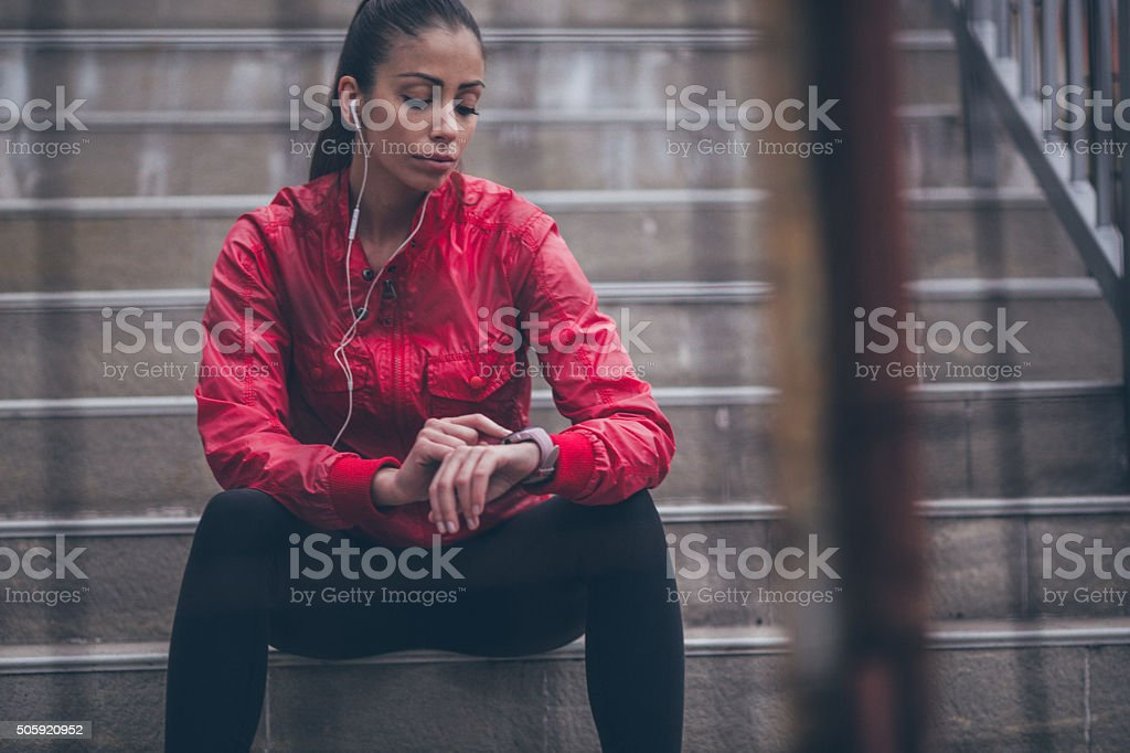 Checking my running time stock photo
