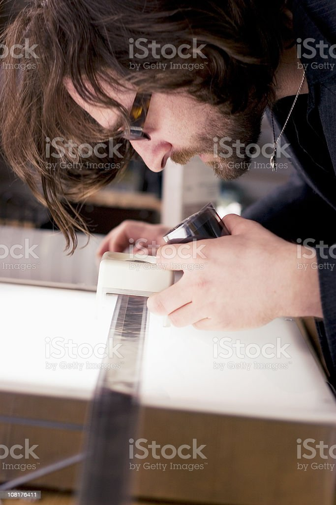 Checking Negatives royalty-free stock photo