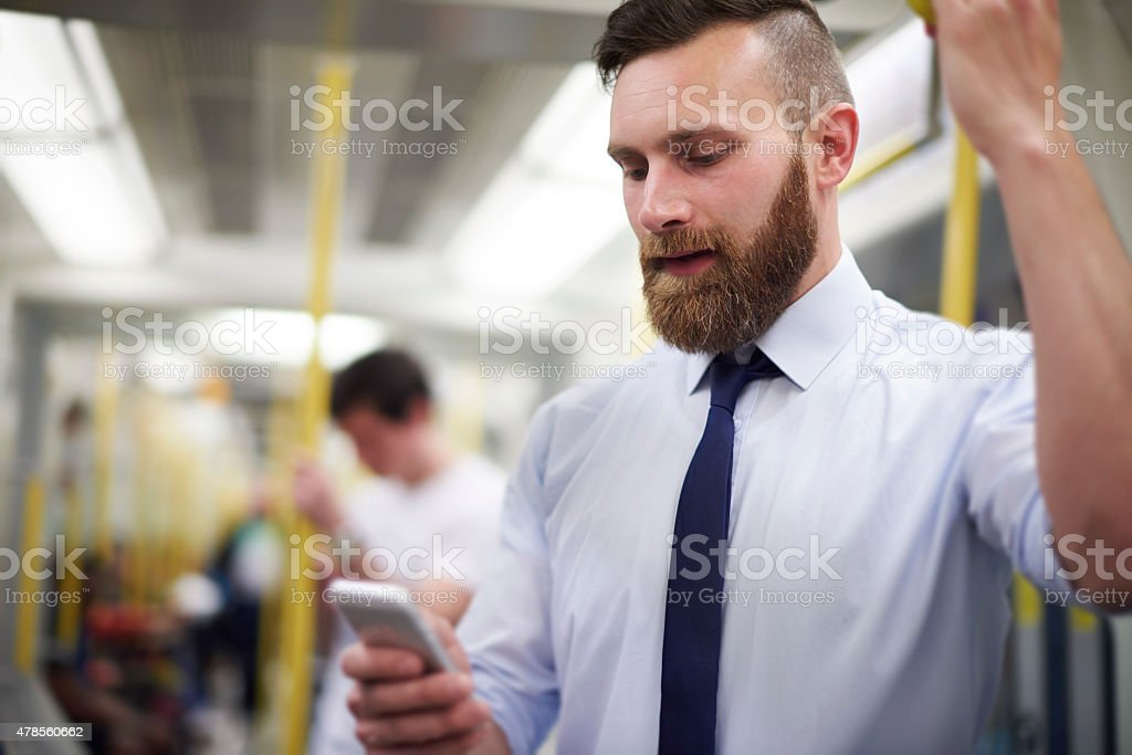 Checking news in way to work stock photo
