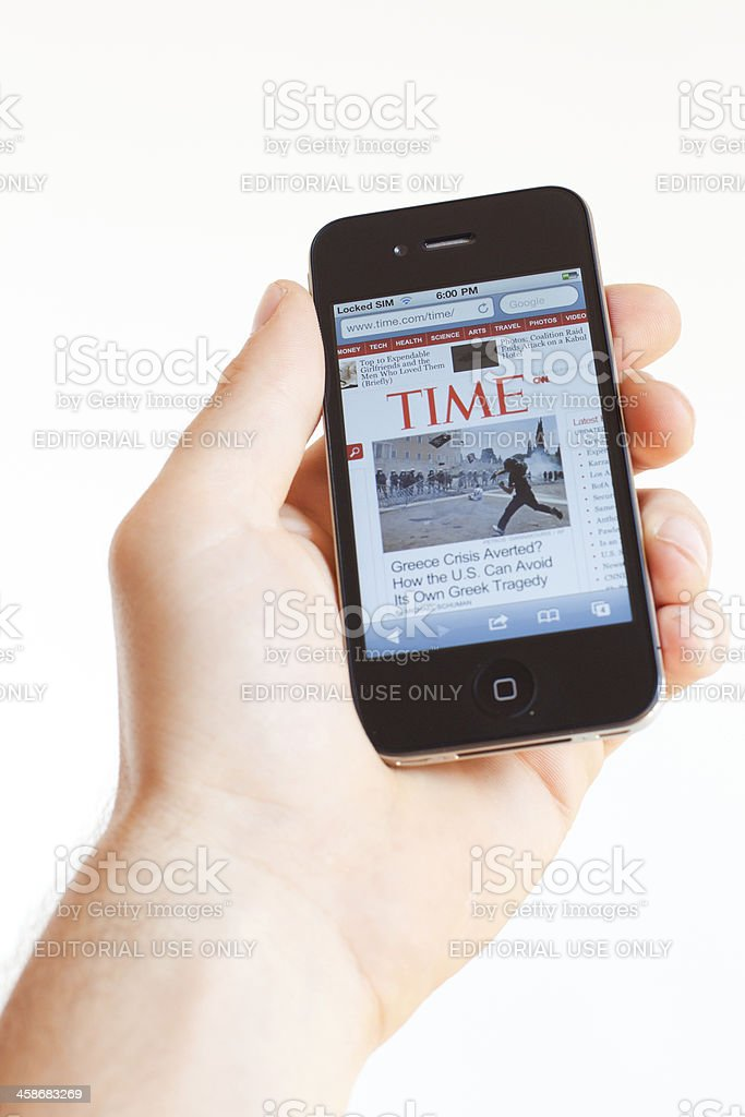 Checking News on Iphone 4 at Time.com Website royalty-free stock photo