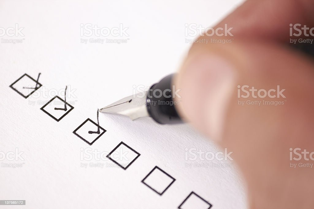 Checking off items in a to do list stock photo