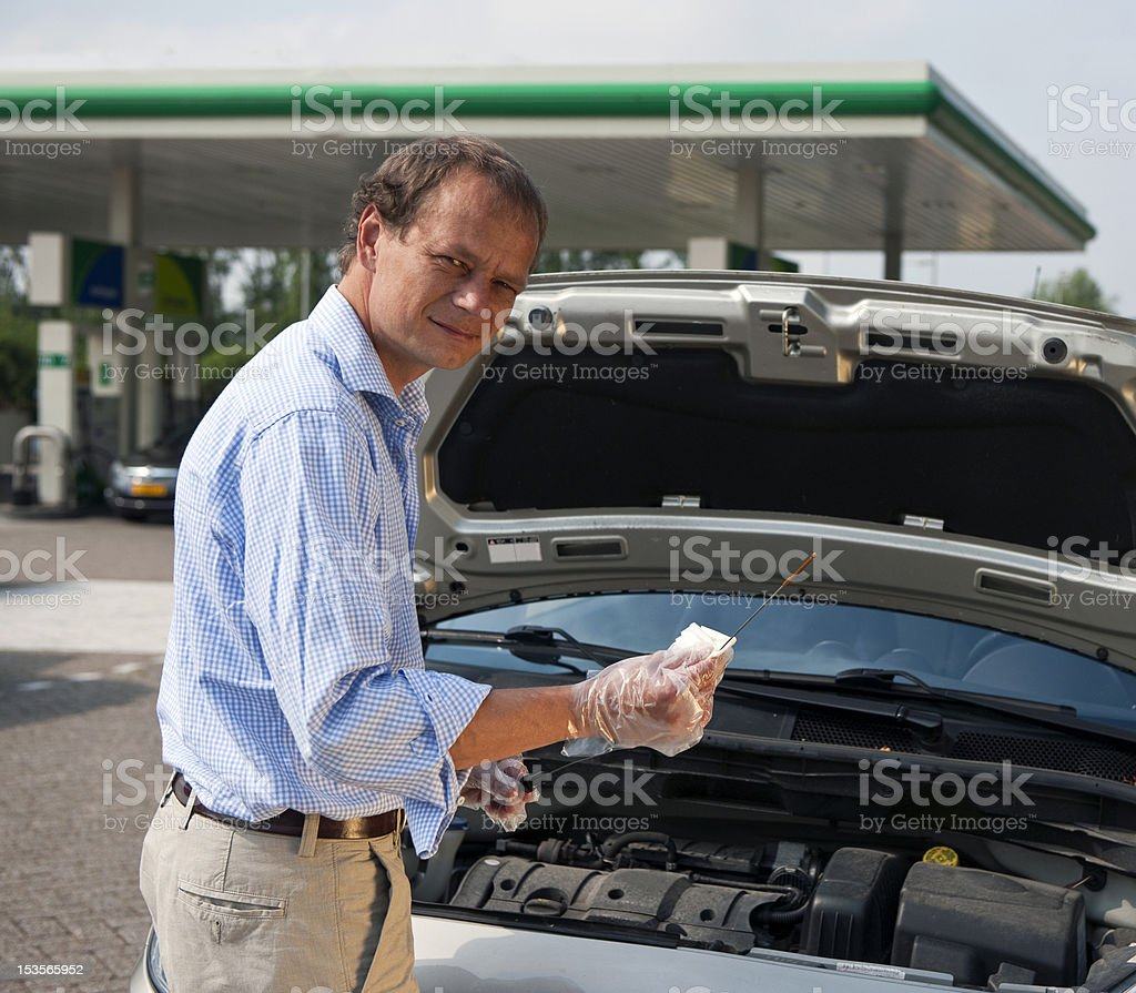 Checking oil levels royalty-free stock photo